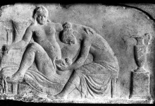 Ancient Roman relief carving of birth